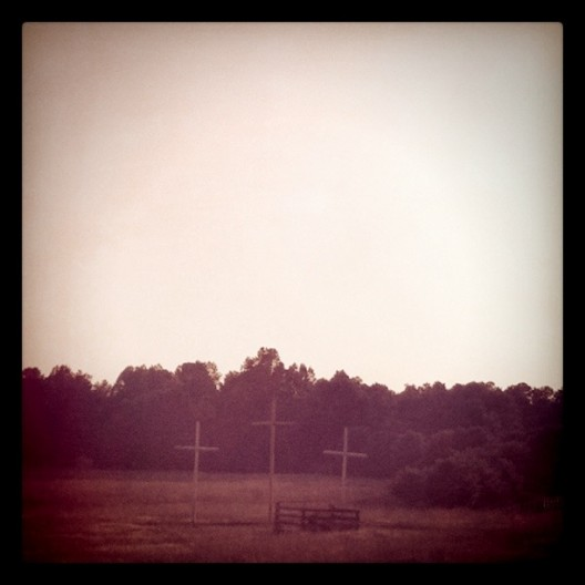 Three Wooden Crosses on the Side of the Road
